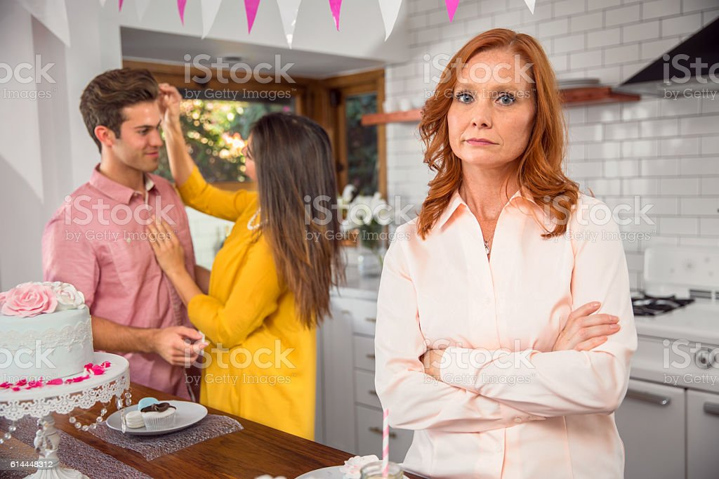 Mother disapproves son girlfriend in-law protective parent abandonment stock photo