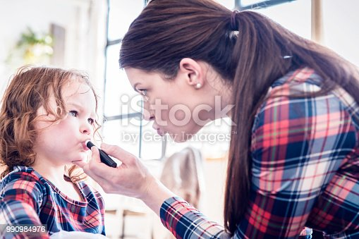 Mother, Daughter, Childhood, Care, Happiness, Makeup, Lipstick, Fashion, NYC, US, Apartment - Single mother and her daughter doing make-up at their living room