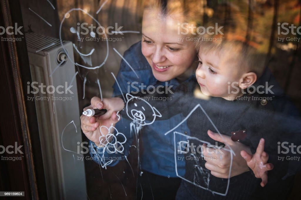 Mother drawing with her cute son stock photo