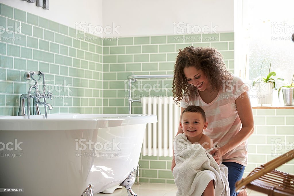 Mother Drying Son With Towel After Bath stock photo