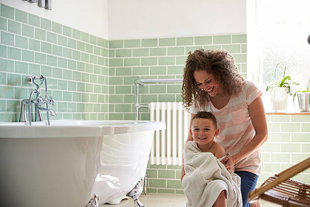 Mother Drying Son With Towel After Bath Mother Drying Son With Towel After Bath bathtub stock pictures, royalty-free photos & images