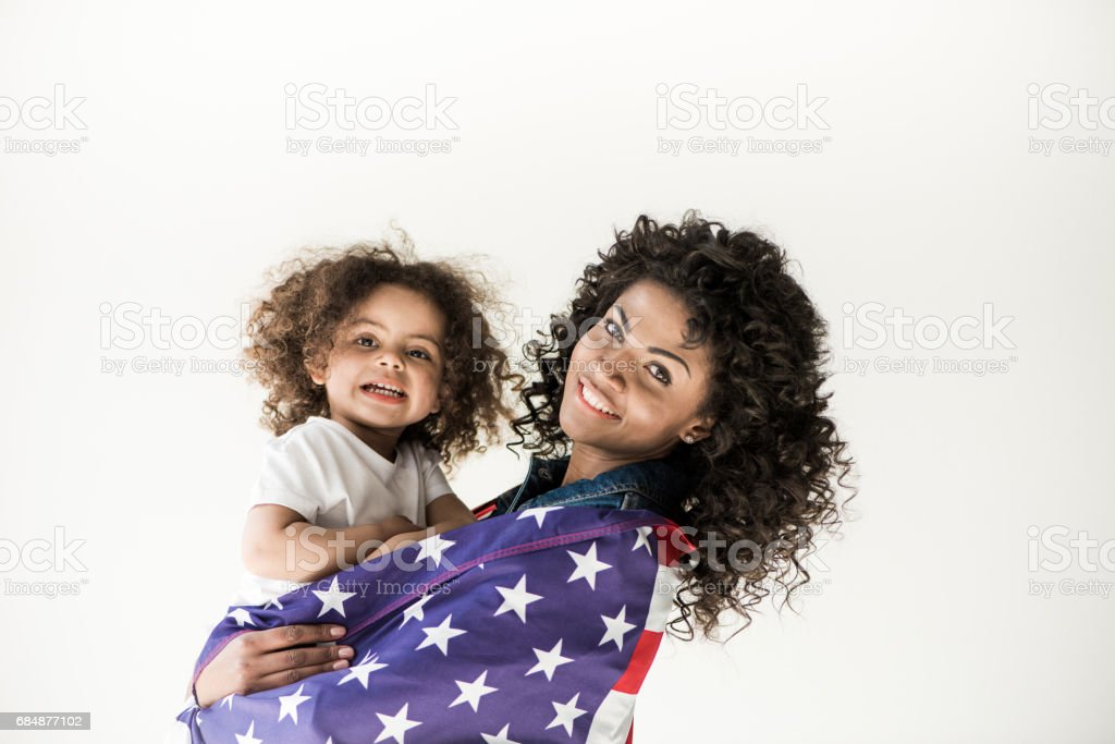 mother embrace daughter stock photo