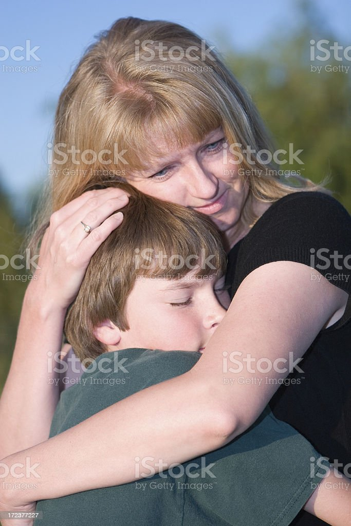 Mother Embracing and Comforting her Young  Son royalty-free stock photo
