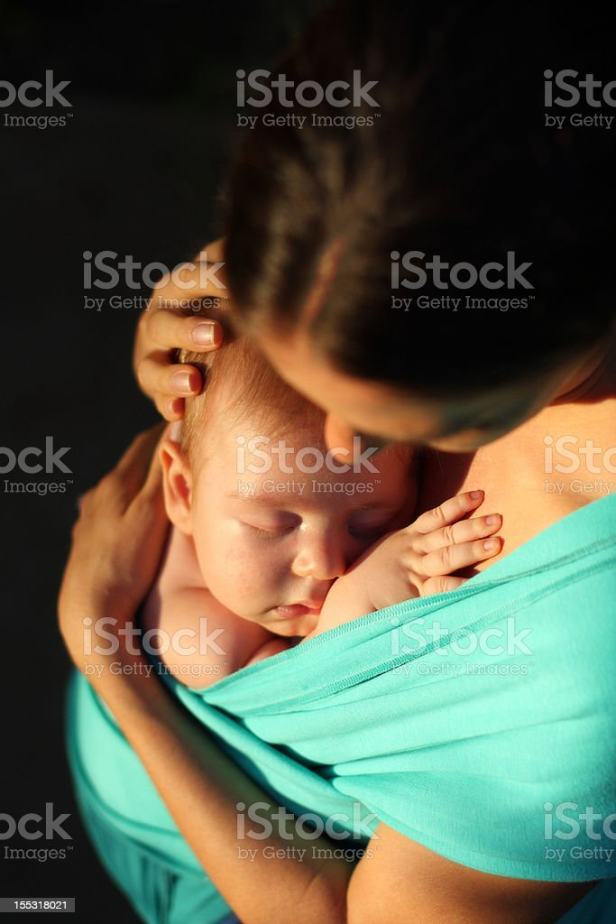 Mother Embracing Baby stock photo