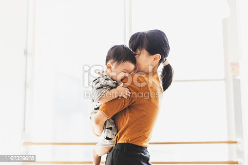Asian mother and son relaxed at cafe.