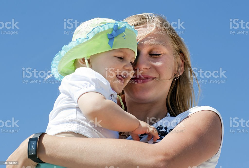 Mother embracing her child royalty-free stock photo
