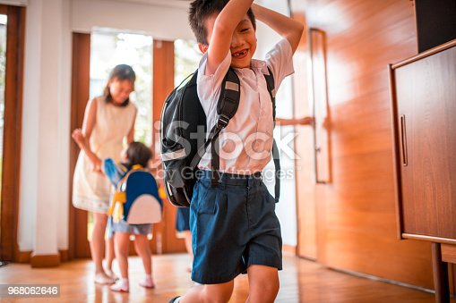 670900812istockphoto Mother embracing her children when coming home 968062646