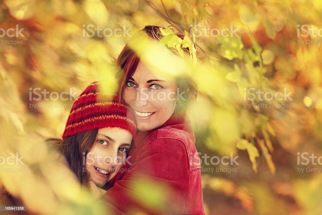 mother embracing her daughter royalty-free stock photo
