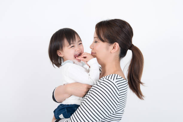 mother embracing her daughter stock photo