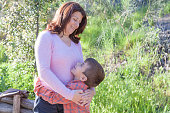 Mother Embracing Son Outdoors