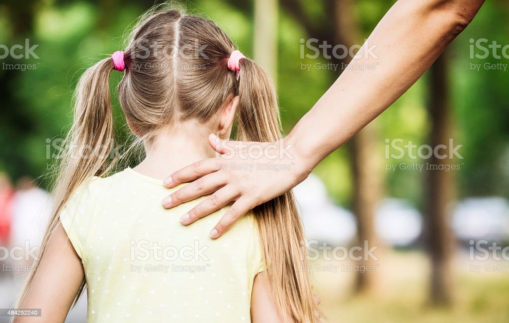 Mother encourages child while walking stock photo