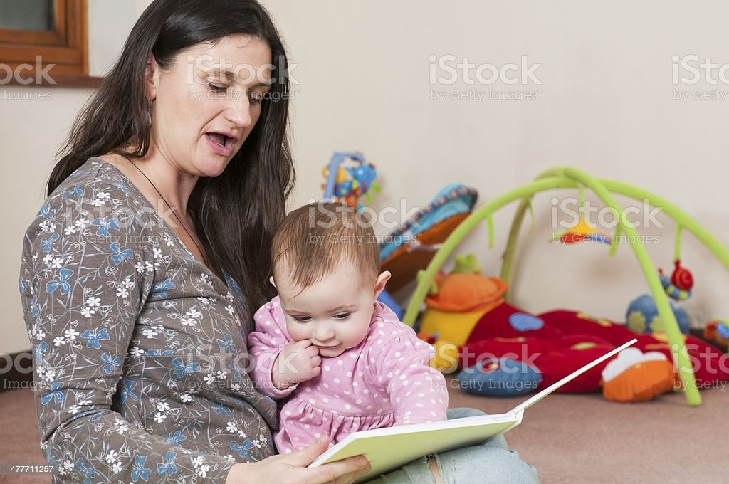 Mother Enjoying Storytime With Her Baby Girl stock photo