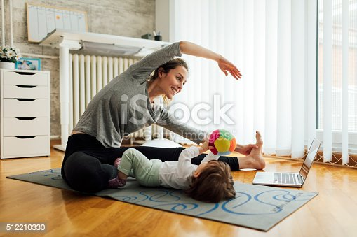 istock Mother Exercise With Her Baby At Home 512210330