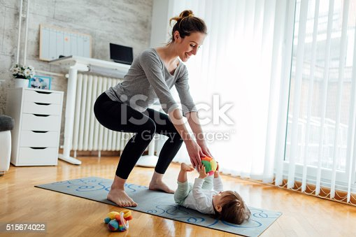 istock Mother Exercise With Her Baby At Home 515674022