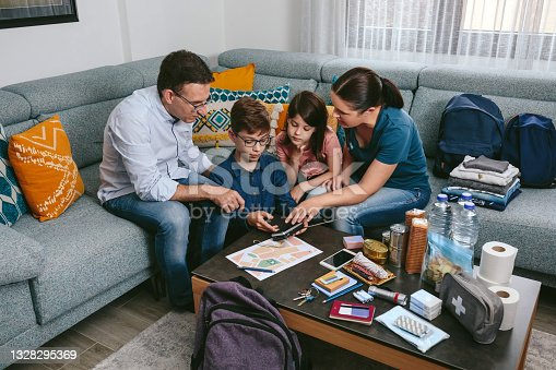 istock Mother explaining to her children how to use the radio in an emergency 1328295369