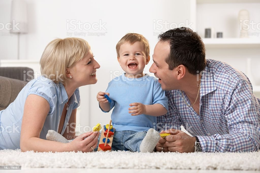 Mother father and baby having fun together royalty-free stock photo