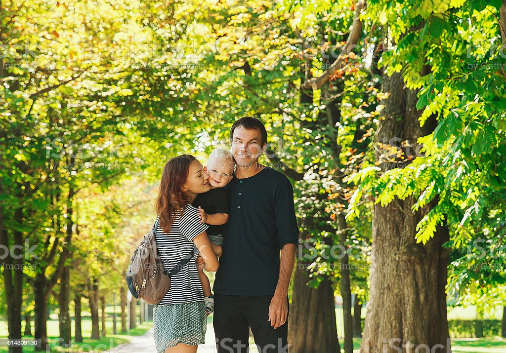 Mother, father and son together spending time outdoors. stock photo