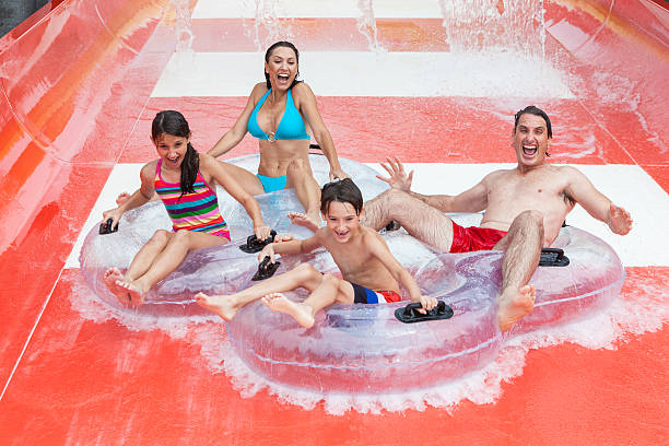 Mother Father Son Daughter Child Family Water Park stock photo