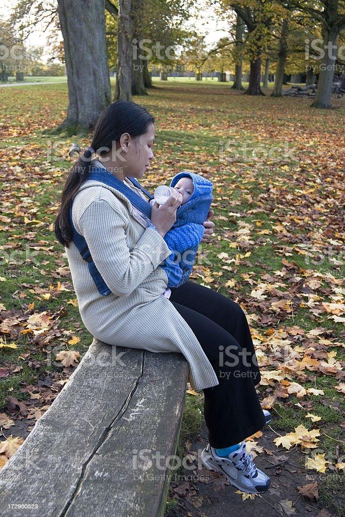 Mother feeding baby royalty-free stock photo