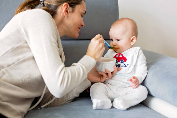 Mother feeding her baby boy with mashed pumpking picture id926731094?b=1&k=6&m=926731094&s=612x612&w=0&h=bk0d9hj hdi55hpz8wa1b fae1pz3p pjesw1kvtams=