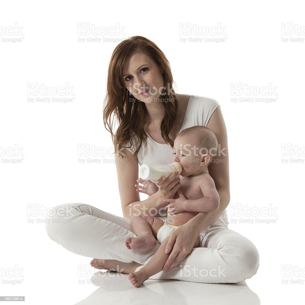 Mother feeding her baby stock photo