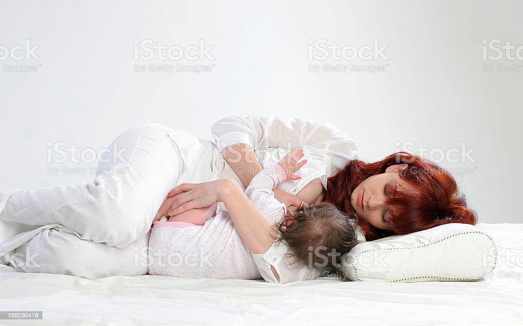 Mother feeding her baby. Position. stock photo