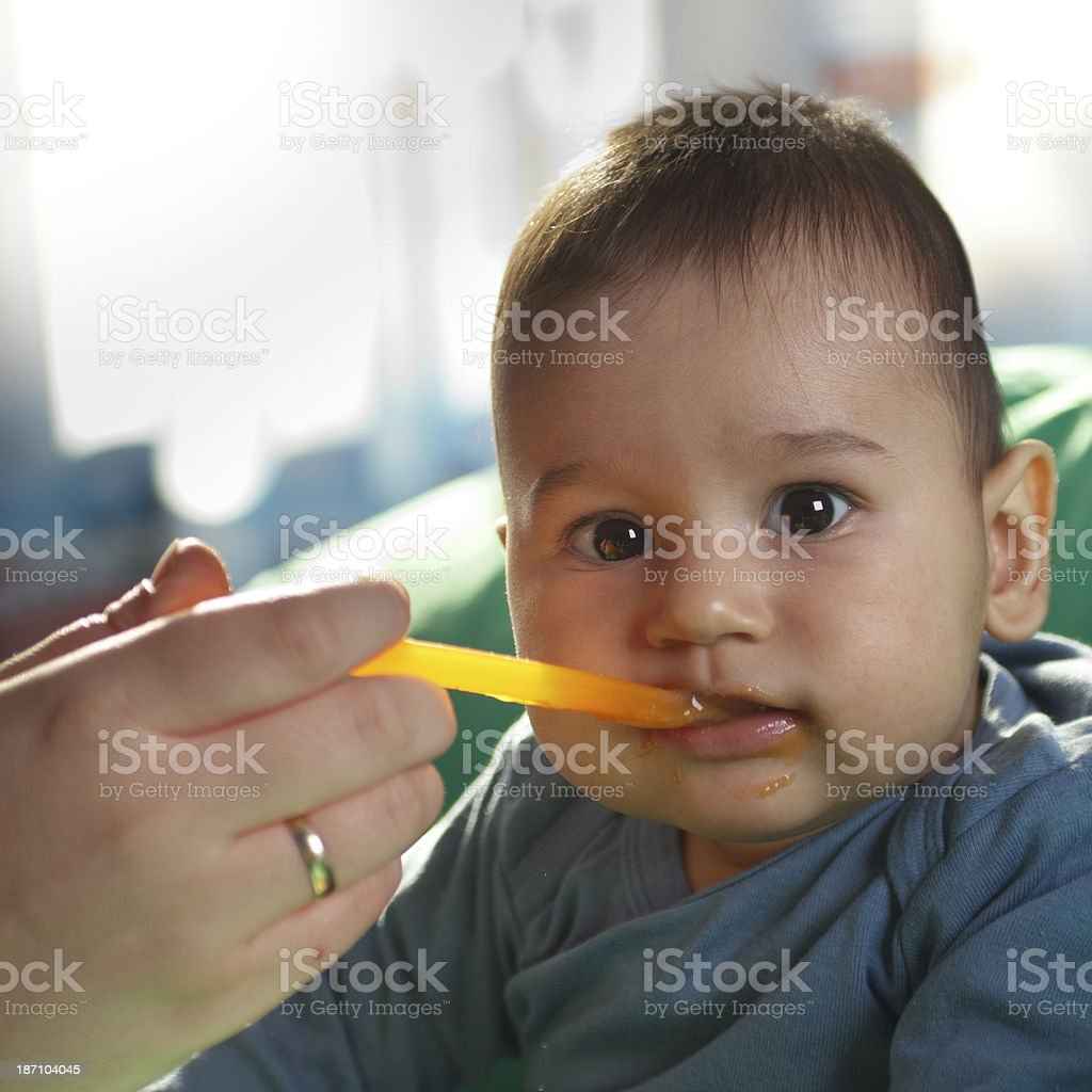 Mother feeding her son royalty-free stock photo