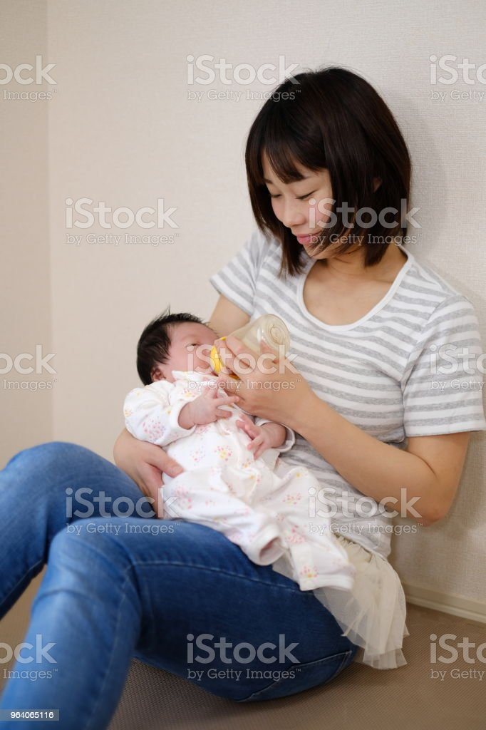 mother feeding milk to baby - Royalty-free 0-1 Months Stock Photo