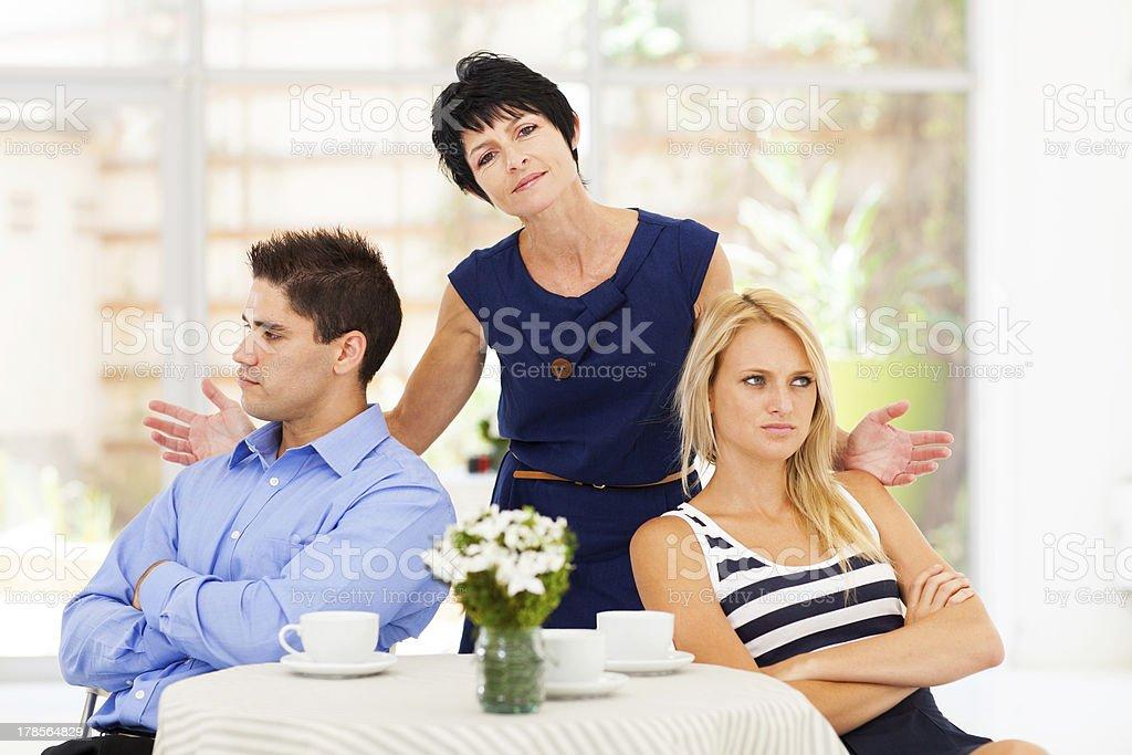 mother feeling helpless when caught in between stock photo