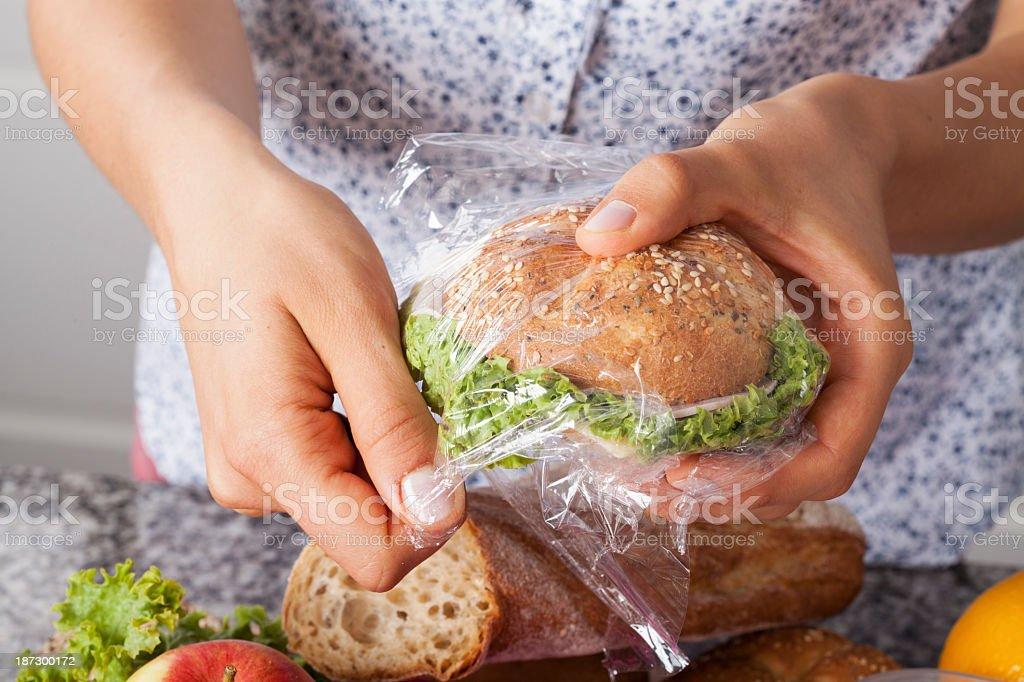 Mother foiling a sandwich stock photo