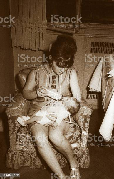 Mother from the sixties feeding her baby