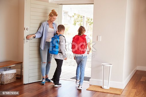 istock Mother Getting Children Ready To Leave House For School 976829334