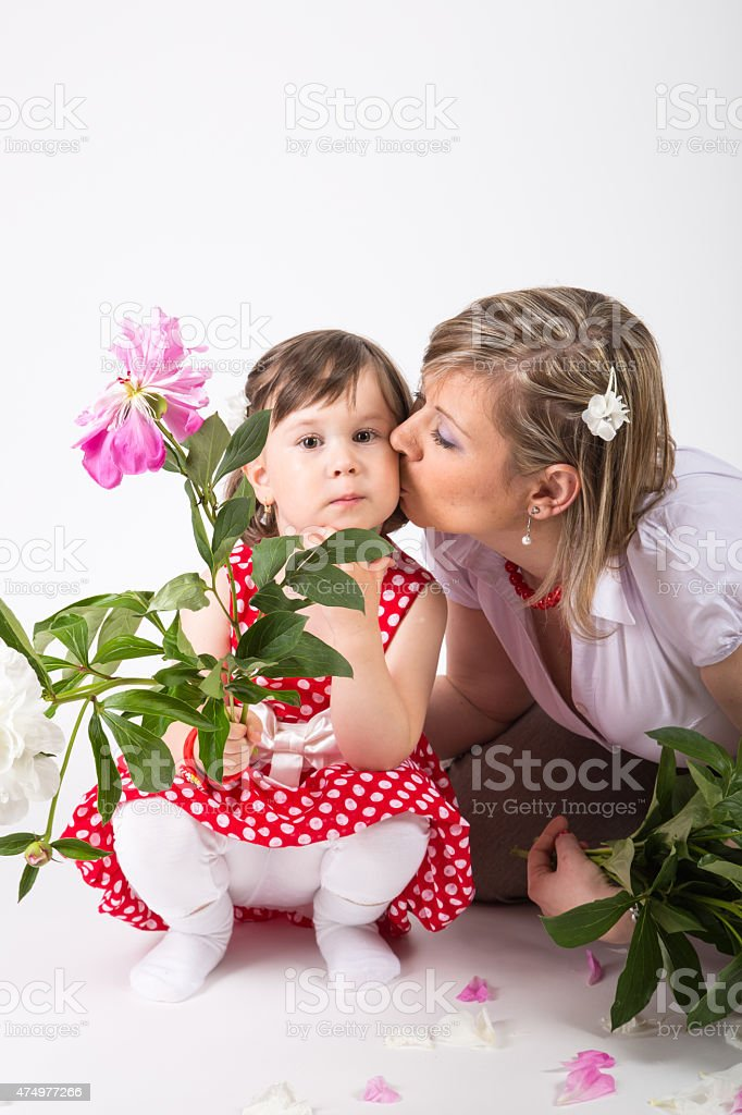 Mother give a kisses for her daughter stock photo