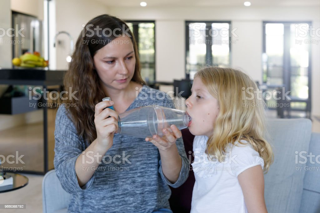 Mother Giving Asthma Treatment To Asthmatic Daughter - Royalty-free 6-7 Years Stock Photo
