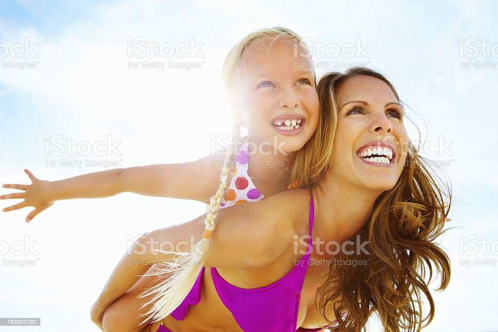 Mother giving daughter airplane ride royalty-free stock photo