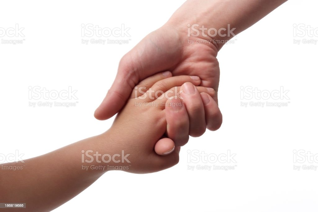 Mother giving hand to a child against white background stock photo