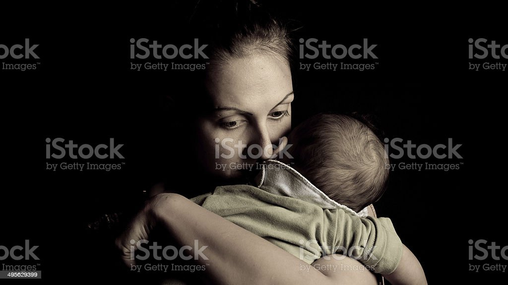 Mother giving love to her child stock photo