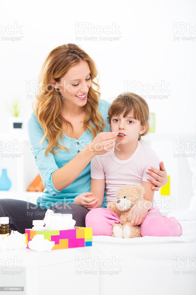 Mother Giving Medicine To Her Child. royalty-free stock photo