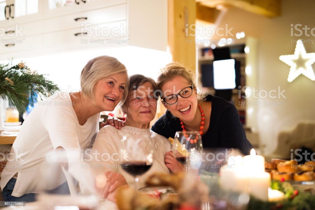 Mother, grandmother and daughter celebrating Christmas. stock photo