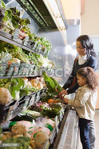 istock mother handing chard to her daughter 535022091
