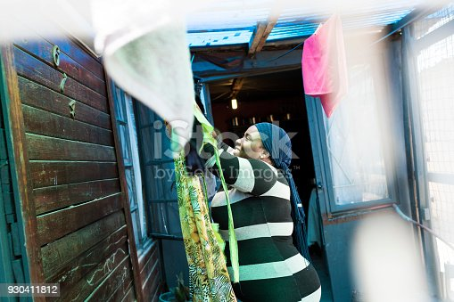 Photo of mother hanging washing on the line