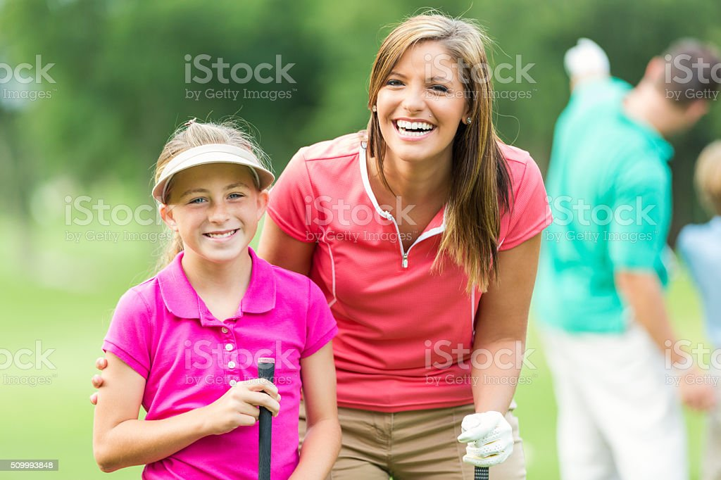Mother have fun while playing golf together stock photo