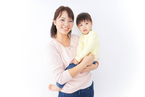 赤ちゃんを持つ母親 ストックフォト