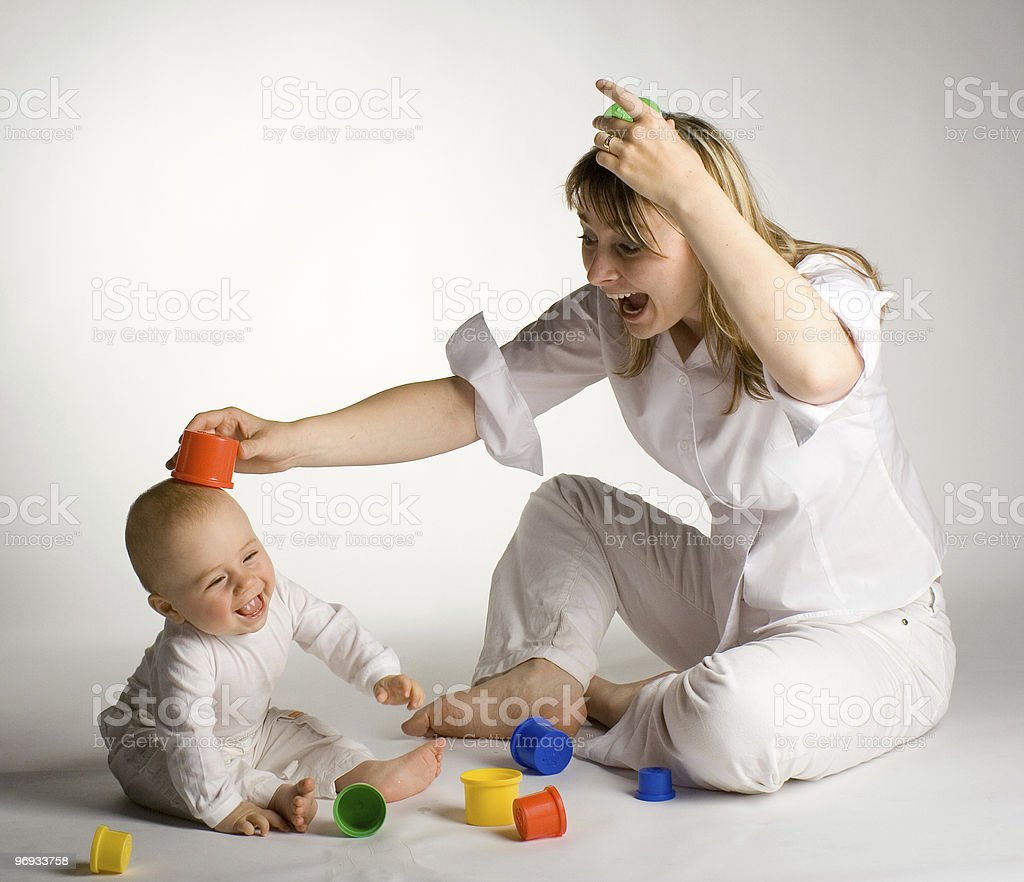 A mother having fun with her infant child royalty-free stock photo