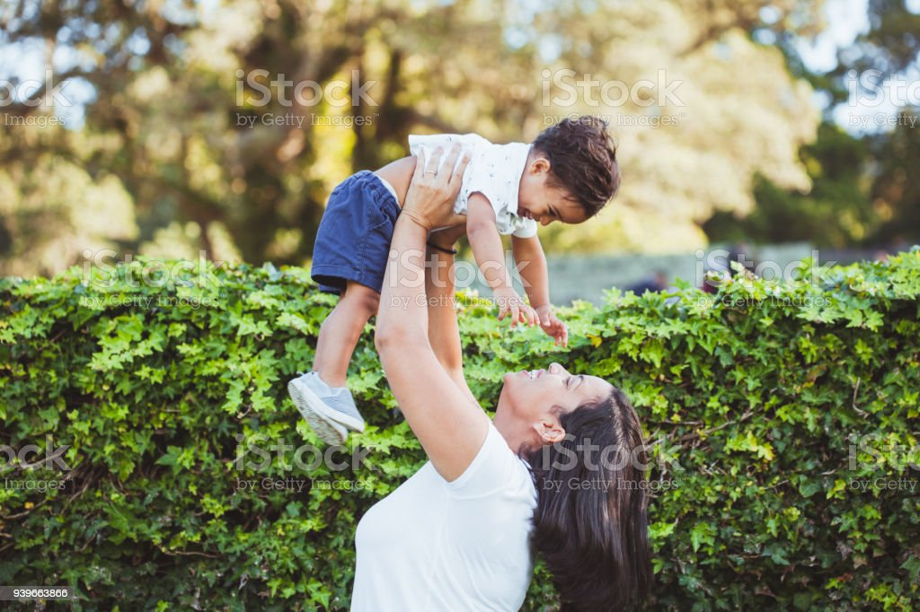 Mother having fun with her son. stock photo