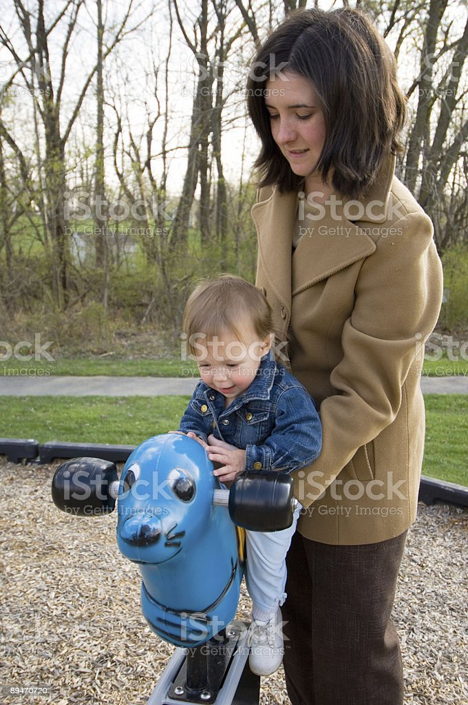 Mother Helping Baby on the Playground royalty-free stock photo