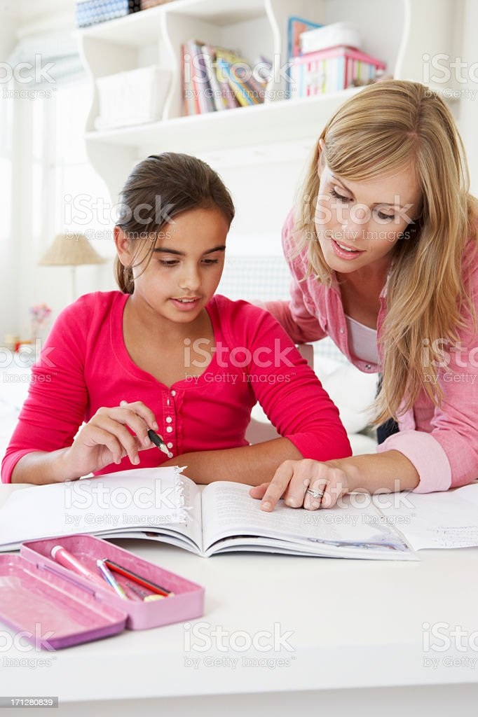 Mother Helping Daughter With Homework royalty-free stock photo