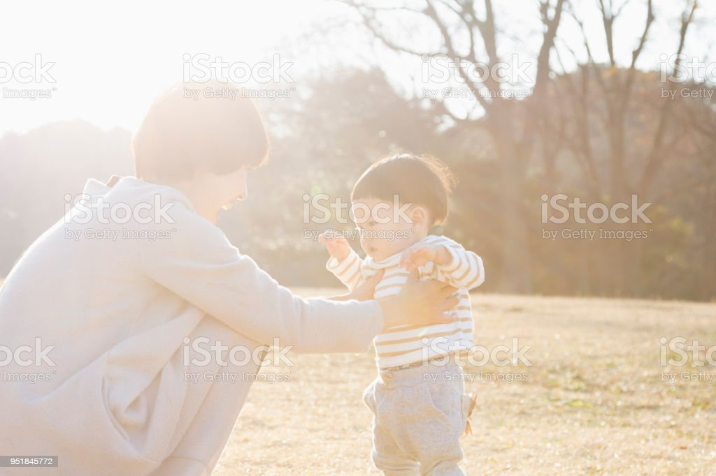 Japanese mother and son relaxed in the park.