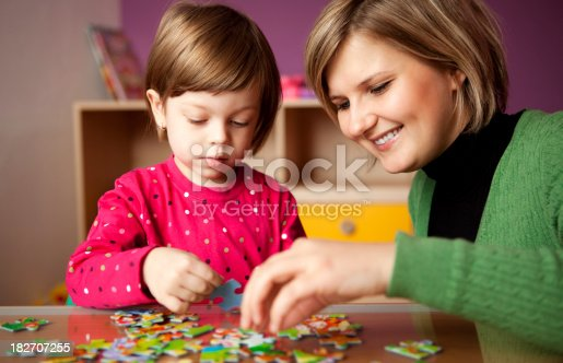 istock Mother helping her daughter with puzzle 182707255