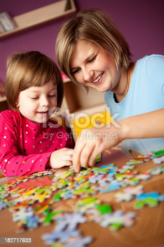 istock Mother helping her daughter with puzzle 182717633